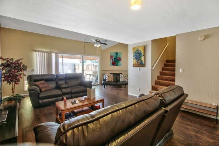 Nice size living room space with not only 2 recliner couches but a futon