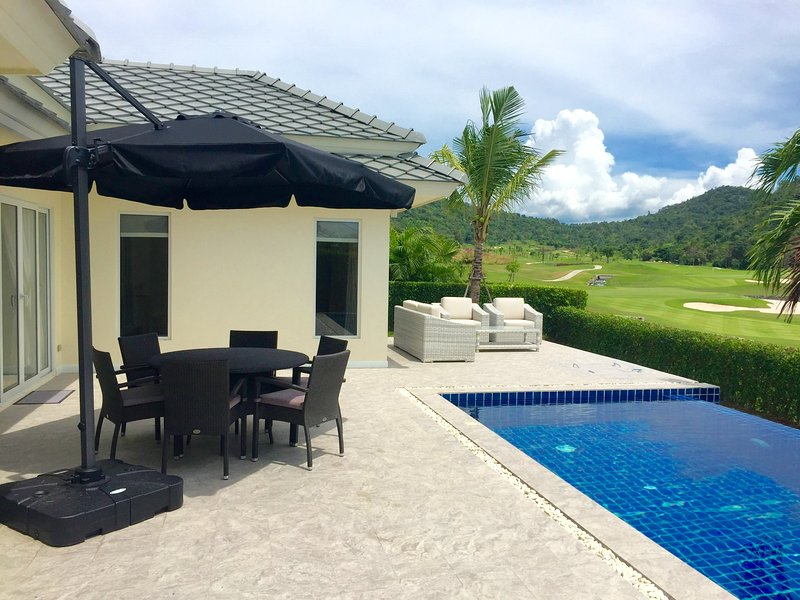 Patio and pool area. The dining table has seating for 6 people.
