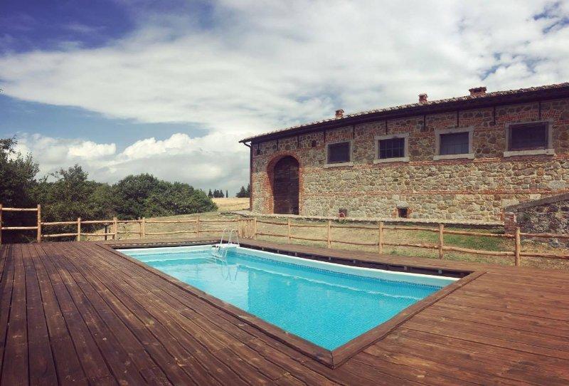 Vue sur la piscine et Podere Palazzone.