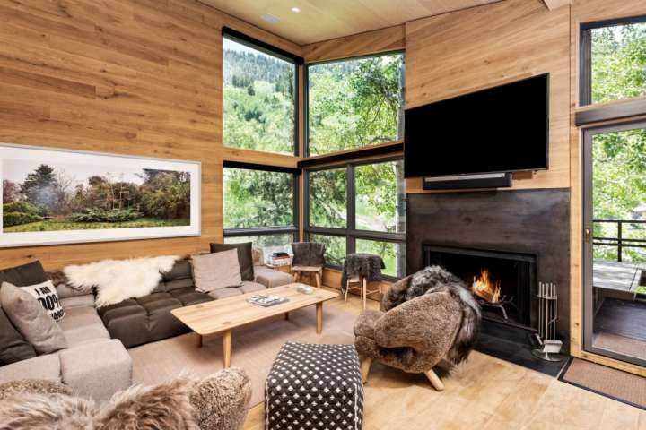 The living area provides a warm, inviting space to curl up and relax after a long day enjoying all that Aspen has to offer.
