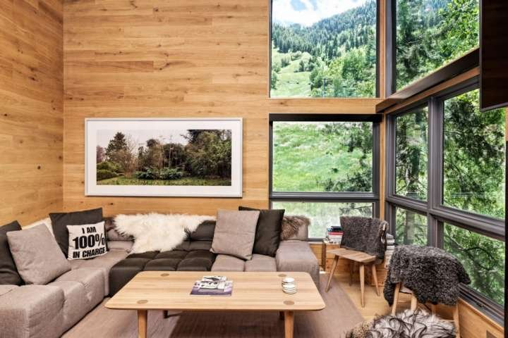Floor to ceiling windows in the living room provide amazing views of Aspen Mountain
