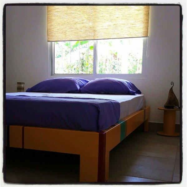 "Habitación Doble Amarilla con cama matrimonial - Apartamento ""Ceiba Amarilla"""