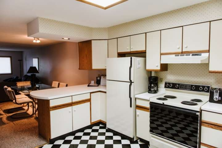 As you enter the property, take a minute to take in this fully equipped kitchen with refrigerator, electric stove, dishwasher, and microwave.