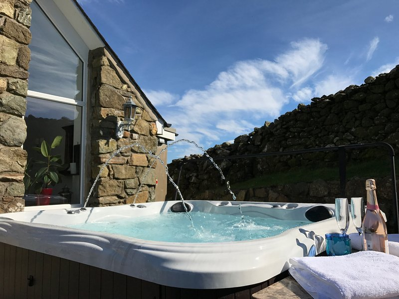 Hot tub with outdoor fireplace and National Trust  dry stone wall