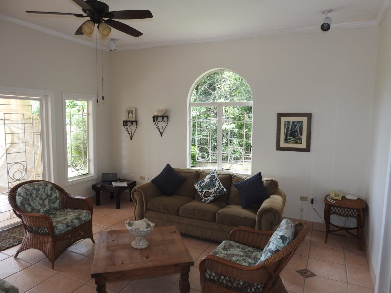 Amenities include enclosed garage area, cable TV, Wi-Fi, laundry facilities and housekeeping service
