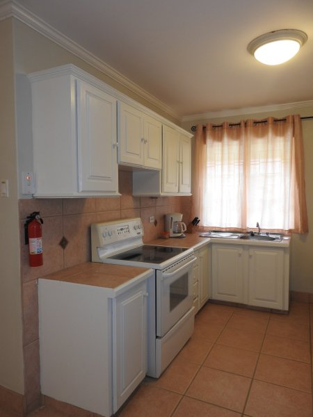 Upstairs bedroom with kitchenette