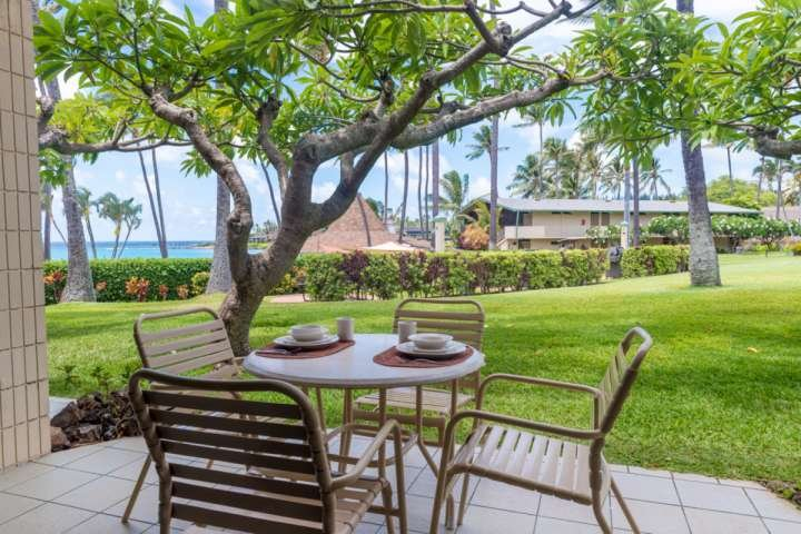 Lanai flows out to grassy area and down to the Gazebo Restaurant and oceanfront pool.