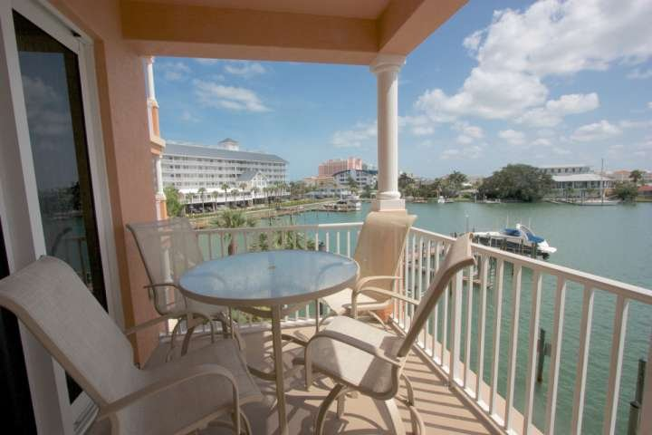 Enjoy a cocktail or Dine Al Fresco while watching the Dolphins and Gorgeous Sunset on this spacious Patio with Intercoastal Views