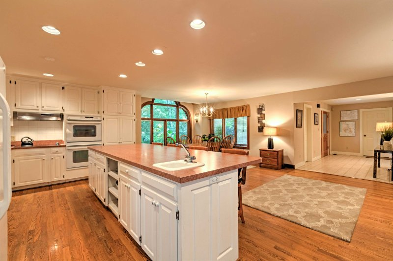 Gorgeous hardwood floors cover the open-concept living space.