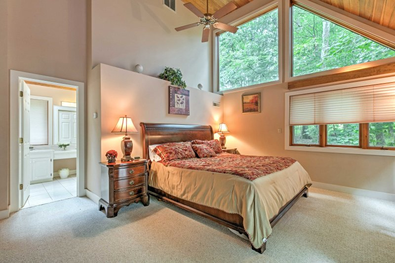 The second master suite also features a comfortable king-sized bed.