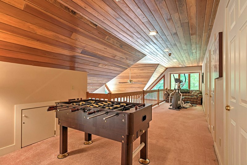 The loft includes a Foosball table, exercise machine and couch.