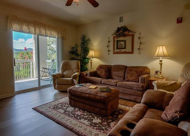 Loveseat, Sofa and Recliner in Living Room