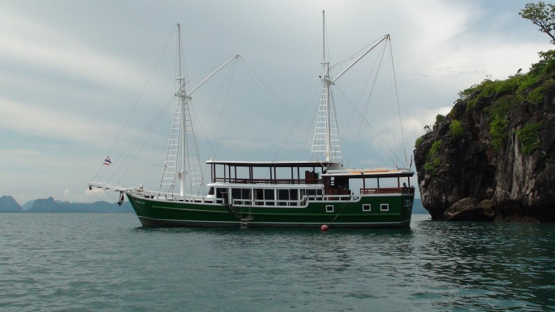 Merdeka in a quiet anchorage. Great snorkeling or take a chill massage whilst you watch the sun set