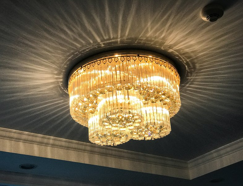 Living Room: Luxurious crystal chandelier sets the mood