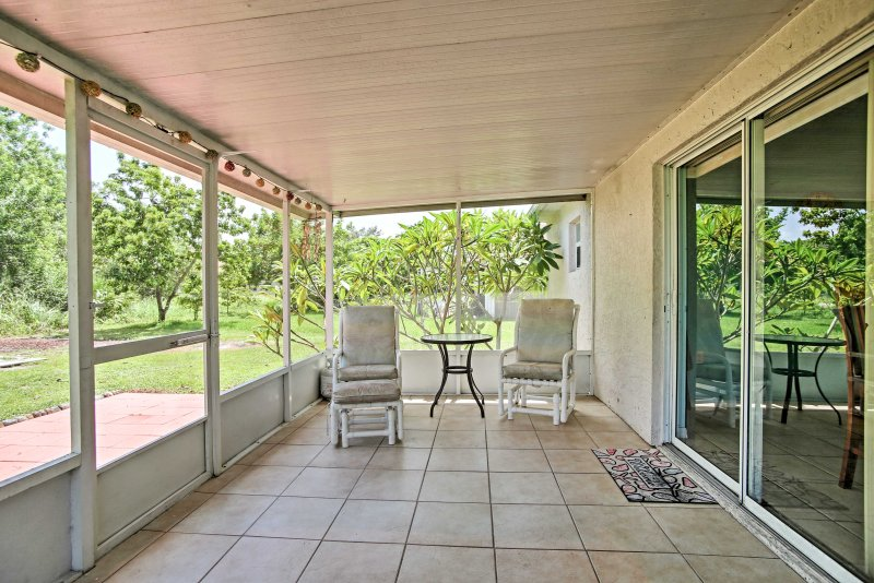 Relax outside on the screened-in porch any time of year.