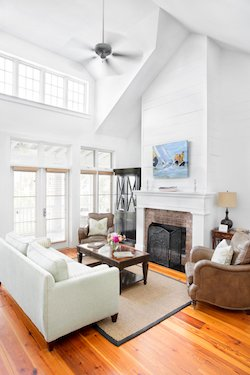 Comfortable living room with gas fireplace and large windows