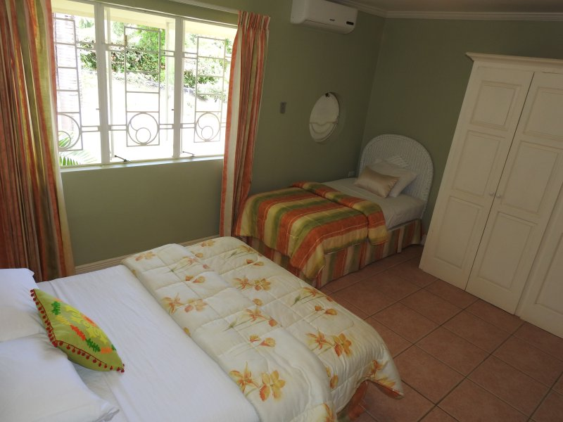Upstairs bedroom with queen size bed and single bed