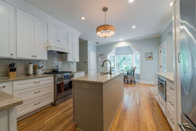 The new kitchen features custom cabinets, Cambria counters, Jenn-Air appliances.