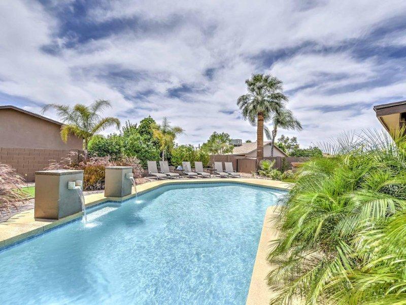 Huge heated pool with suntan area.