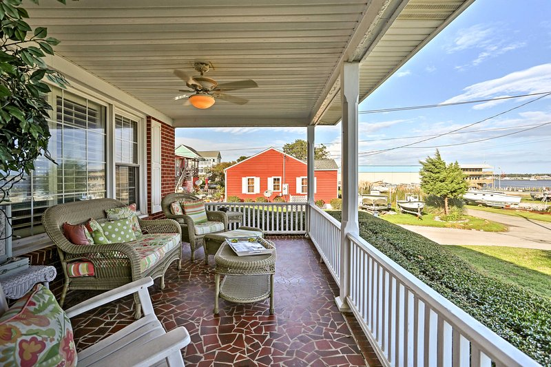 The front porch is sure to be a favorite spot during your stay with water views!