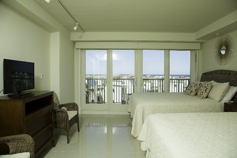 Master bedroom fully equipped with two queen beds, a large closet and a private restroom.