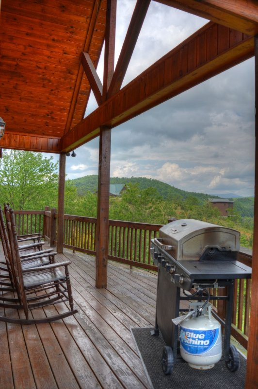 Covered Deck with Gas Grill and 4 Rocking Chairs