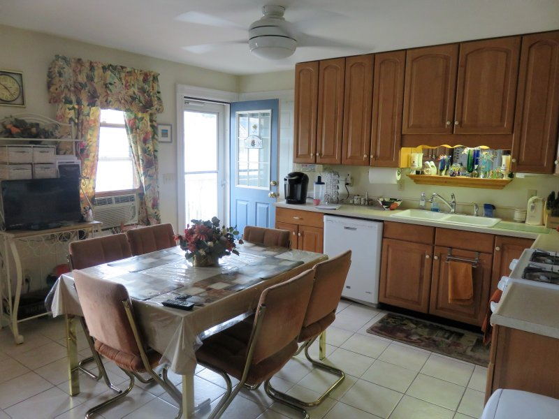 large eat in kitchen with all the amenities including direct tv, keurig, full size fridge.