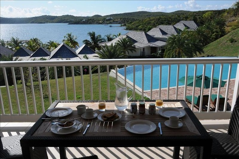 Breakfast on the balcony with gorgeous views out over the pool and Nonsuch Bay
