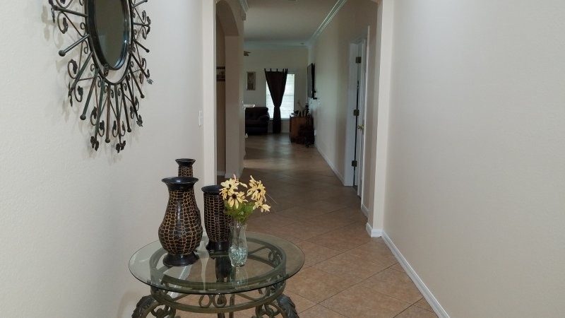 Walking in front door (To The Right Are Bedrooms 3 & 4, Hallway, Linen Closet and 2nd Bathrooms