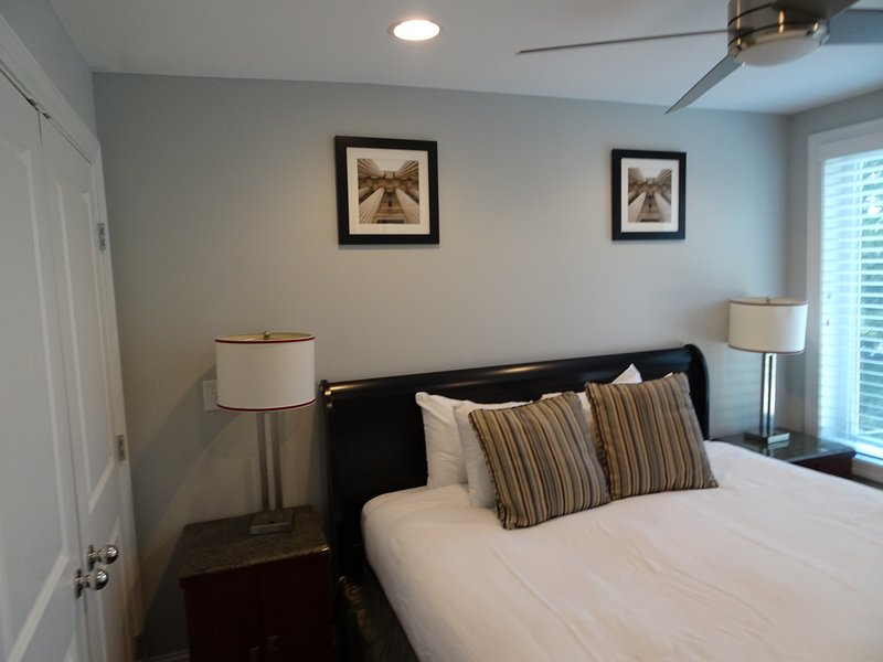 One of two bedrooms.  KING Bed & Walk in Full Bath