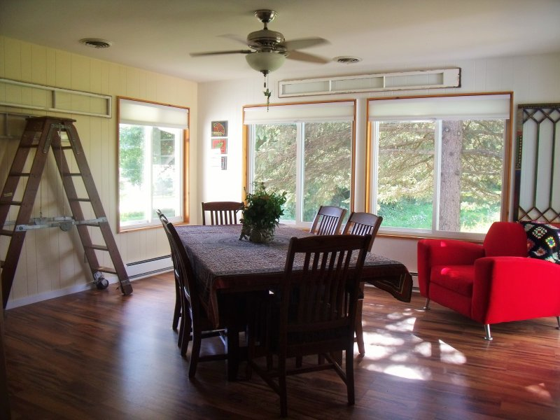 large sunny dining room with patio access