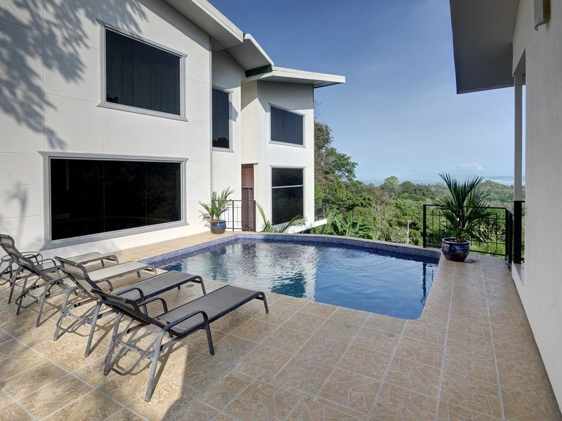 The pool and deck separate the main house from the casita