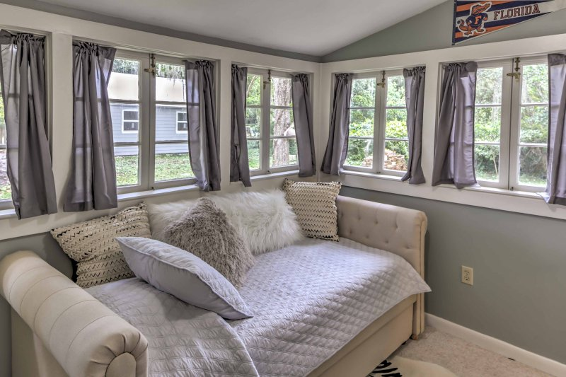 Rest easy in the sun room where guests can lie back in the twin day bed and trundle bed.