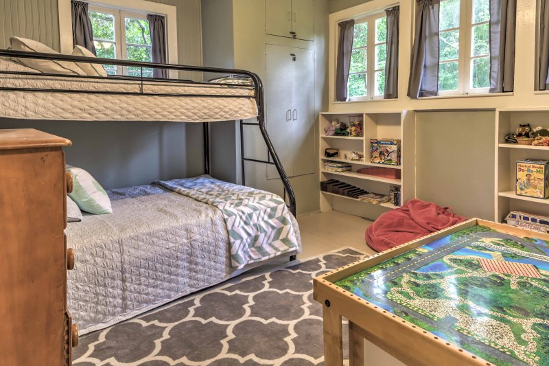 Kid's can enjoy their own space in the playful second bedroom with toys, games, and a cozy twin-over-full bunk bed to ensure peaceful nights and fun-filled days.
