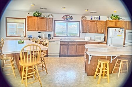 Dining areas and fully equipped kitchen
