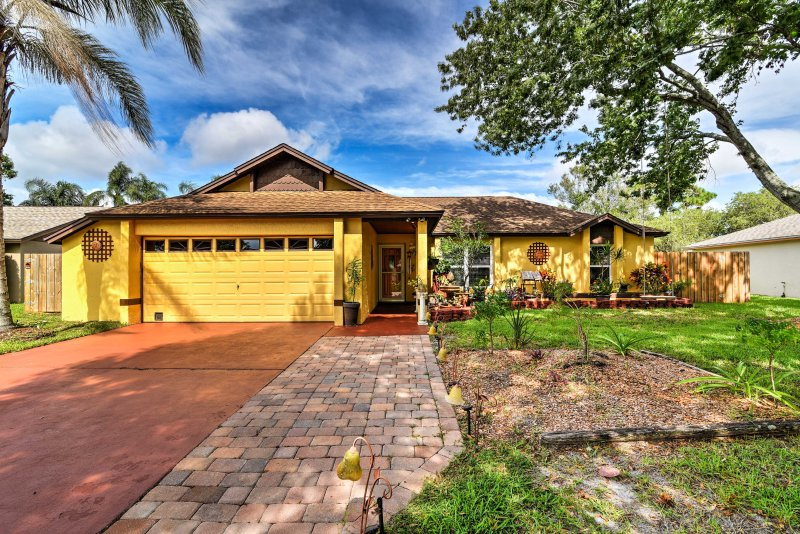 This charming cottage is an outdoor oasis with a screened-in pool and lanai!