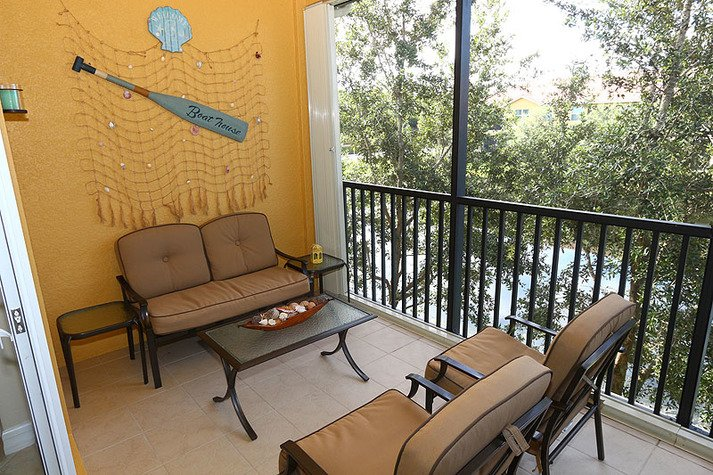 Screened in patio with wonderful seating space