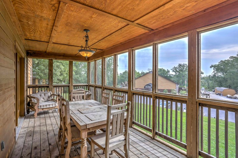 You can enjoy meals with your travel companions on the screened-in porch.