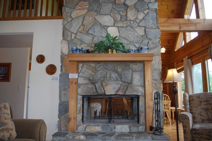 Living Room - with two sided wood fireplace