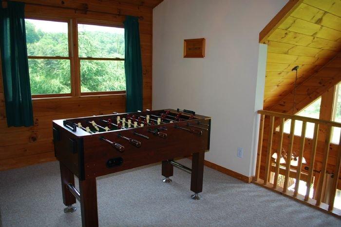 Loft area with foosball table