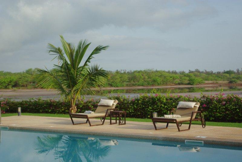 Swimming pool with lagoon views