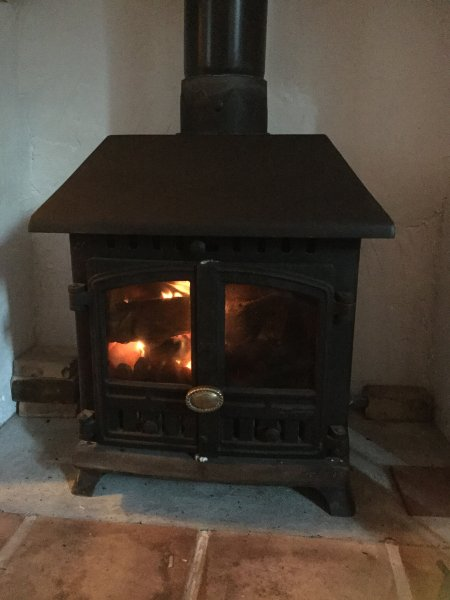 The multi fuel stove in the living room. Logs can be bought from the village shop.