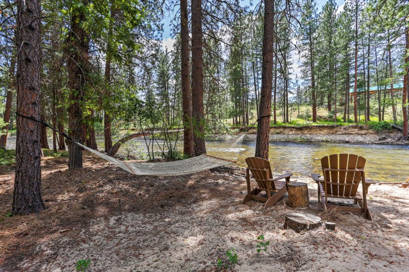 Lounge in the hammock by the river during your stay at this vacation rental.