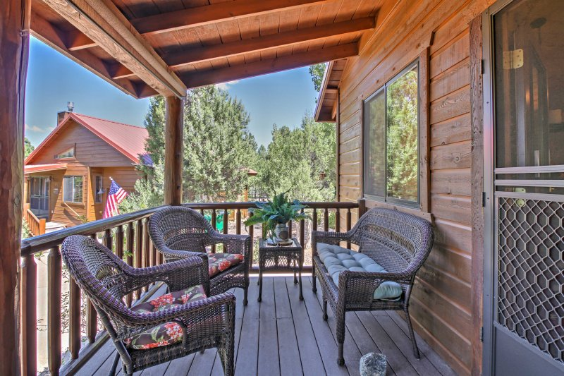 Soak up the private and peaceful community from the porch with comfortable patio furniture.