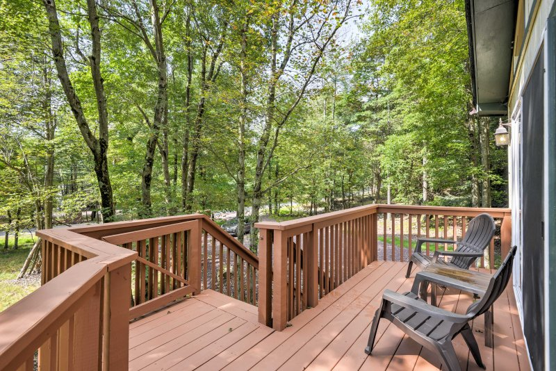 This home is surrounded by towering trees and located close to ski resorts!
