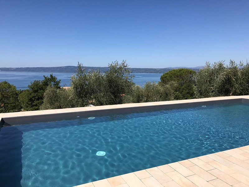 12x5 meter saltwater pool with sun beds and outdoor kitchen