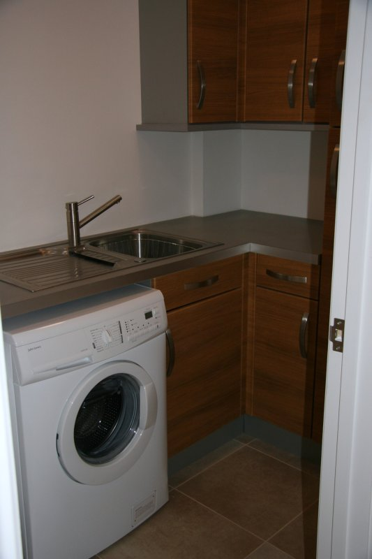 Utility with washing machine and separate tumble dryer and drying rack -not seen
