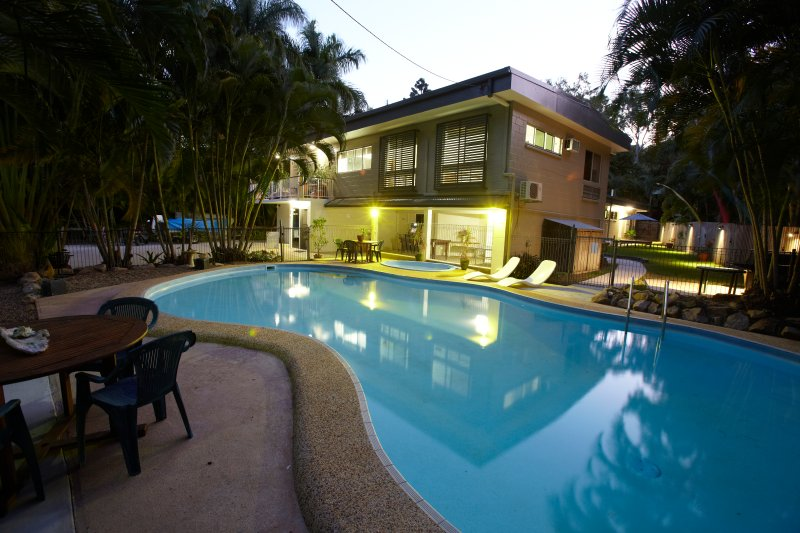 Large inground pool with sun loungers and outdoor table and chairs