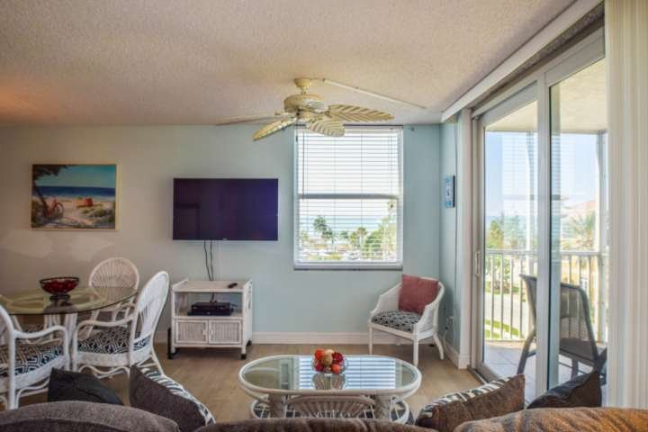 Wall mounted large screen tv with full cable package, and stunning gulf views from the sofa sleeper and bed.