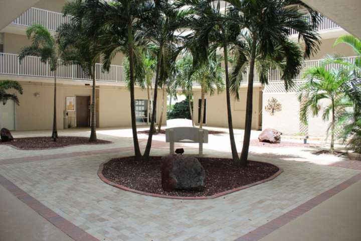 The courtyard entrance to your condo, with two elevators, laundry facilities, massage studio, and real estate office.
